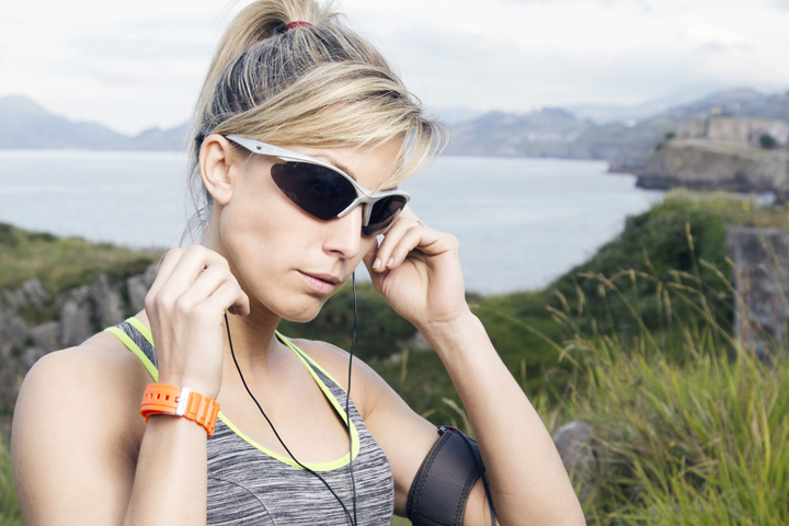 Woman wearing sunglasses preparing to jog