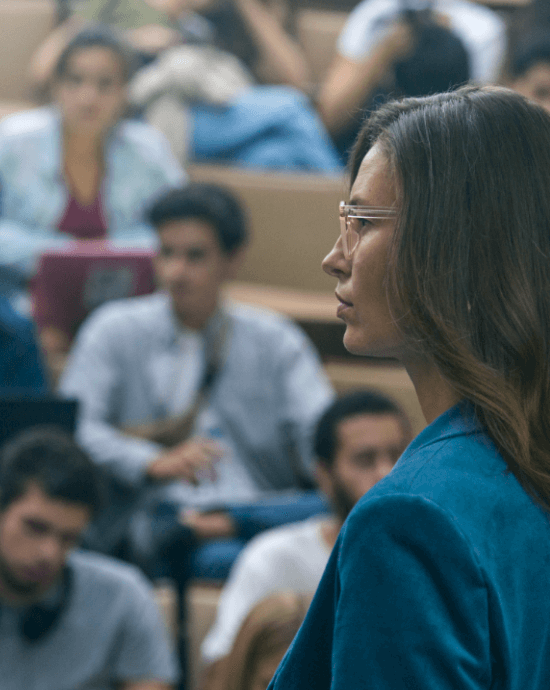 See more with a glance - lady wearing Varilux X series in a lecture hall