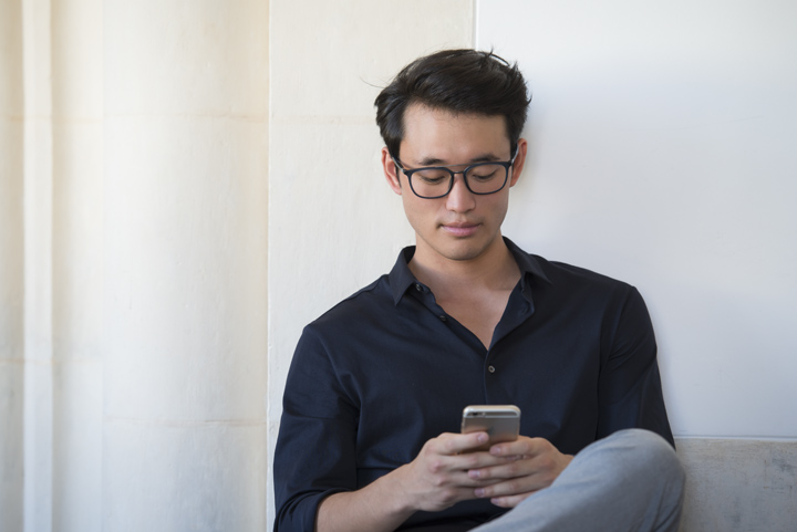 Man comfortable looking at smartphone