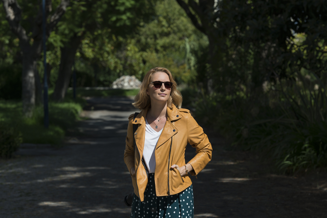 Woman wearing Transitions lenses walking in a park