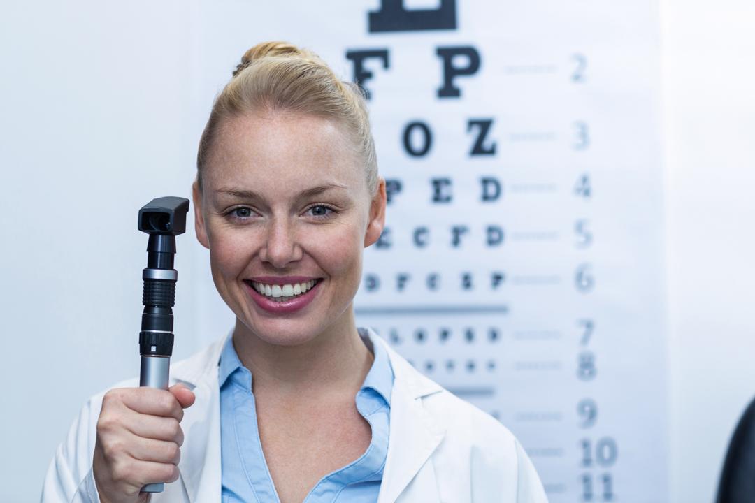 Eyecare professional holding Opthalmascope