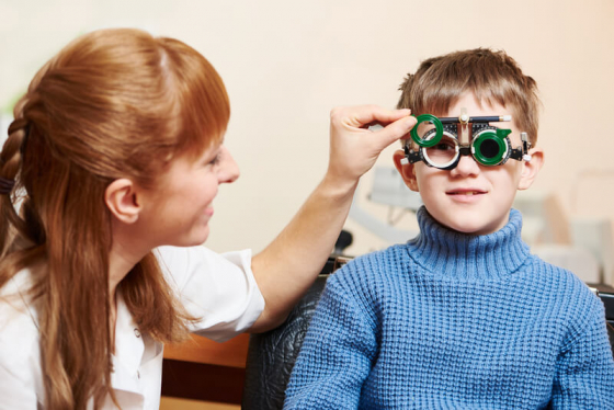 child having his eye tested