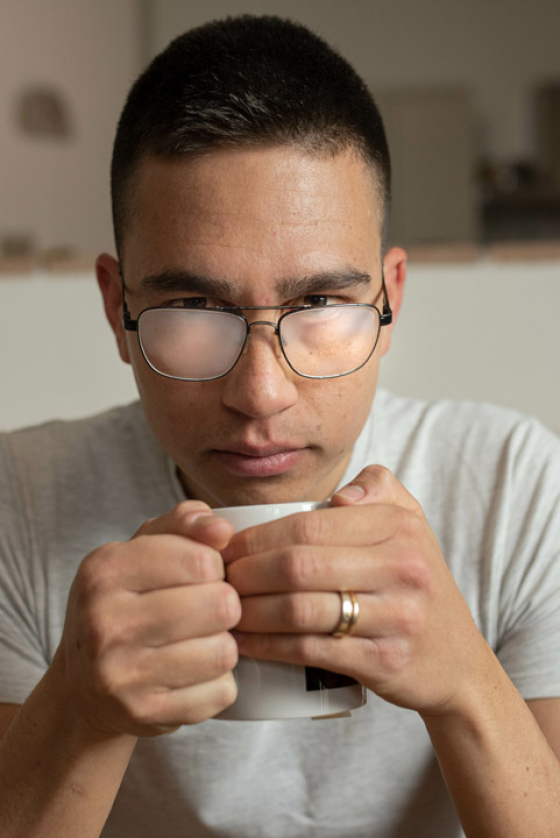Person drinking tea with steamed up glasses