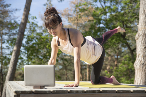 Woman wearing varifocal lenses doing yoga