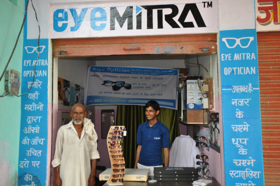 An Eye Mitra stood in his practice with a patient