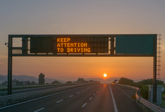 Road sign saying Keep Attention To Driving