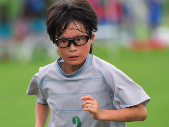 Footballer wearing glasses