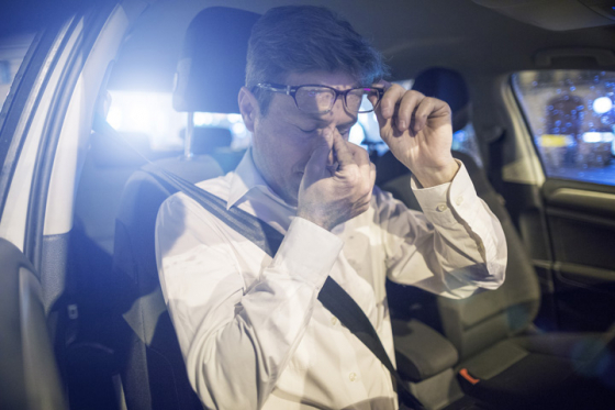 man experiencing eye fatigue when driving