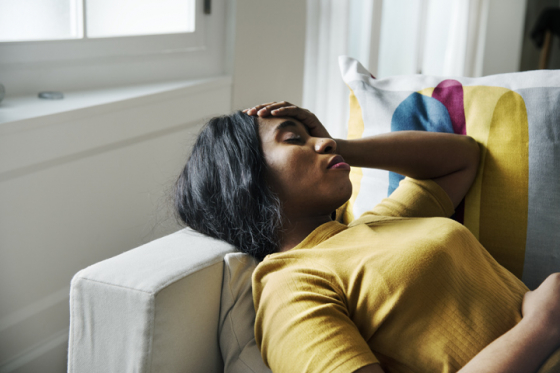 Woman led on sofa due to migraine