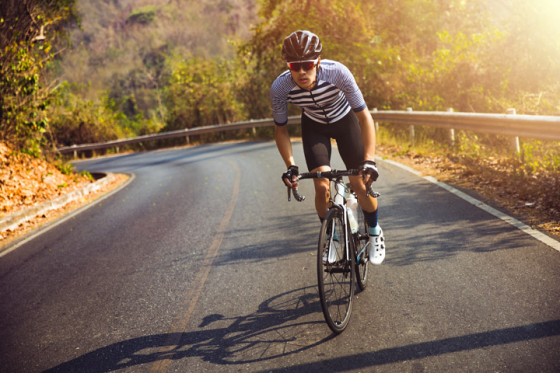 Man riding a bike wearing sunglasses