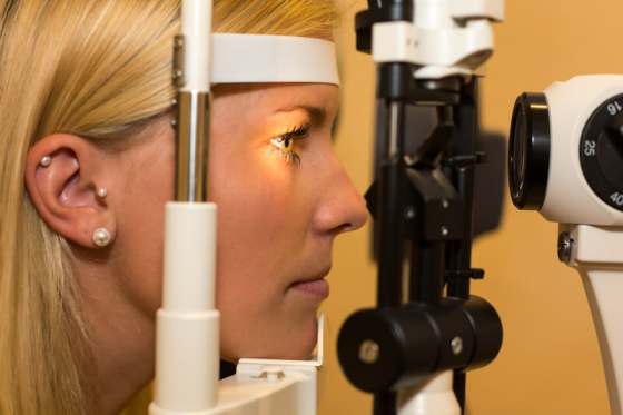 woman having an eye examination for photophobia