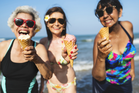 Ladies eating ice cream on the beach