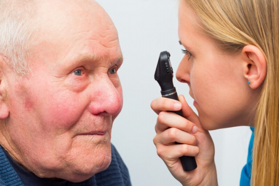 a mans eyes being examined for glaucoma by an optician
